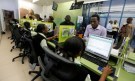 Employees serve customers inside a mobile phone care centre operated by Kenyan's telecom operator Safaricom in the central business district of Kenya's capital Nairobi, May 11, 2016. REUTERS/Thomas Mukoya - D1AETDLLWWAA