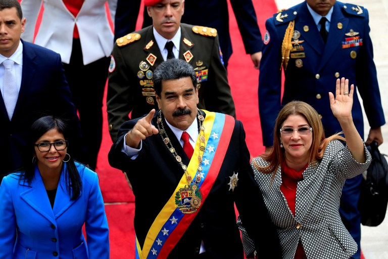 Venezuela's President Nicolas Maduro, flanked by his wife Cilia Flores and National Constituent Assembly President Delcy Rodriguez, arrives for a special session of the National Constituent Assembly to take oath as re-elected President at the Palacio Federal Legislativo in Caracas, Venezuela May 24, 2018.