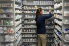 A technician stocks the shelves of the pharmacy at White House Clinic in Berea, Kentucky, U.S., February 7, 2018. Picture taken February 7, 2018. REUTERS/Bryan Woolston - RC19281A85B0