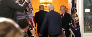 White House National Security Advisor John Bolton (R) departs with U.S. President Donald Trump and Vice President Mike Pence after Trump announced his intention to withdraw from the JCPOA Iran nuclear agreement during a statement in the Diplomatic Room at the White House in Washington, U.S. May 8, 2018.  REUTERS/Jonathan Ernst - RC14BD742E20