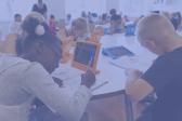 Children taking a test at desks