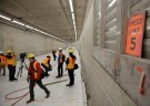Media are pictured on the lower level northbound lanes, during a tour of the double deck State Route 99 highway tunnel, under construction in Seattle, Washington, U.S., March 27, 2018. REUTERS/Jason Redmond - RC183C60D230