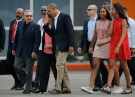 U.S. President Barack Obama and his daughters Malia and Sasha are accompanied by Cuba's President Raul Castro as they walk towards Air Force One at the end of their visit to Cuba, at Havana's international airport, March 22, 2016.  REUTERS/Carlos Barria - TB3EC3M1NKZOF