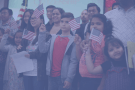Children holding little American flags