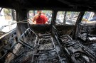 A Buddhist monk looks through the window of a burnt car after Muslims attacked and set fire to a temple in Cox's Bazar October 1, 2012. Bangladesh accused Muslim Rohingya refugees from Myanmar on Monday of involvement in attacks on Buddhist temples and homes in the southeast and said the violence was triggered by a photo posted on Facebook that insulted Islam. REUTERS/Andrew Biraj (BANGLADESH - Tags: RELIGION CIVIL UNREST) - GM1E8A11KYB01