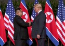 U.S. President Donald Trump shakes hands with North Korean leader Kim Jong Un at the Capella Hotel on Sentosa island in Singapore June 12, 2018. REUTERS/Jonathan Ernst - RC1BF3A56C10