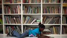 Iana Williams, 8, reads a book