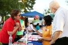 A health insurance navigator explains services at a booth in Arizona