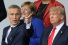NATO Secretary General Jens Stoltenberg gestures as German Chancellor Angela Merkel and U.S. President Donald Trump look on at the start of the NATO summit in Brussels, Belgium July 11, 2018.   REUTERS/Reinhard Krause - RC16A17ED300