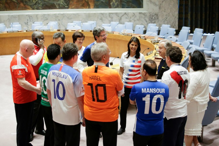 Members of the United Nations Security Council gather together before posing for a picture while wearing soccer jerseys to commemorate the inauguration of the World Cup.