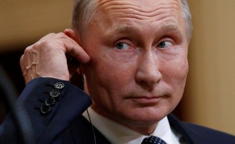 Russian President Vladimir Putin listens as U.S. President Donald Trump speaks during their news conference in Helsinki, Finland July 16, 2018.  REUTERS/Kevin Lamarque - RC188258ED00