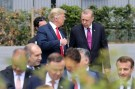 U.S. President Donald Trump speaks withh Turkey's President Tayyip Erdogan ahead of the opening ceremony of the NATO (North Atlantic Treaty Organization) summit, at the NATO headquarters in Brussels, Belgium, July 11, 2018.  Ludovic Marin/Pool via REUTERS - RC188FED2910