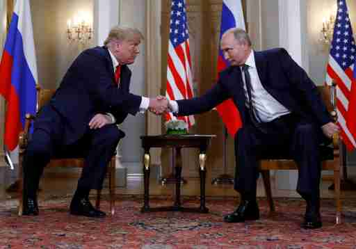 U.S. President Donald Trump and Russia's President Vladimir Putin shake hands as they meet in Helsinki, Finland July 16, 2018. REUTERS/Kevin Lamarque     TPX IMAGES OF THE DAY - RC19BE6D3090