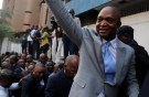 Former Congolese interior minister Emmanuel Ramazani Shadary waves to his supporters as he arrives to file his candidacy for the presidential election, at the Congo's electoral commission (CENI) head offices at the Gombe Municipality in Kinshasa, Democratic Republic of Congo, August 8, 2018. REUTERS/Kenny Katombe - RC1CD82EFFD0