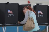 Melissa Foye fills out her ballot as she votes in the U.S. presidential election at the National Guard Armory in Smithfield, North Carolina, U.S. November 8, 2016. REUTERS/Chris Keane - HT1ECB81E4Y70