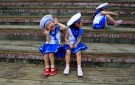 Children dressed in sailor outfits play before a performance during World Oceans Day celebrations in Taipei June 8, 2011. REUTERS/Nicky Loh (TAIWAN - Tags: SOCIETY) - GM1E7681AQU01