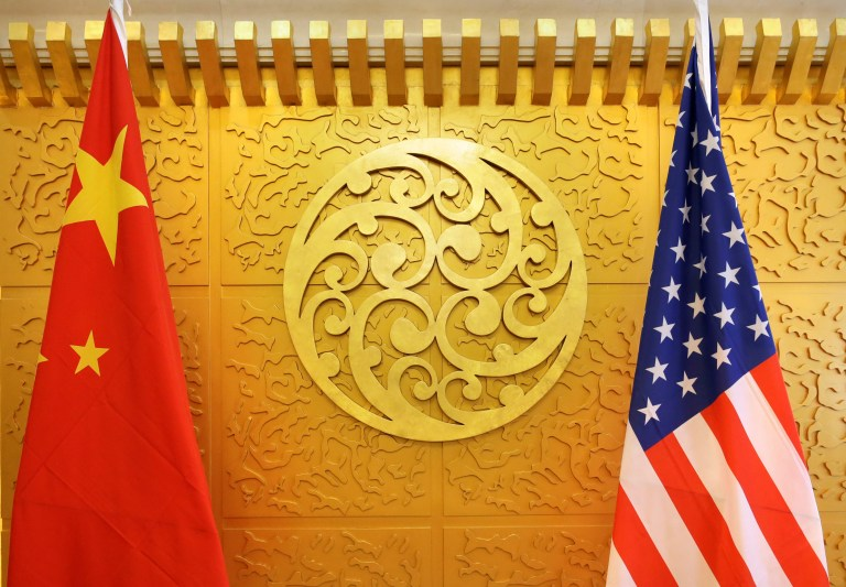 Chinese and U.S. flags are set up for a meeting during a visit by U.S. Secretary of Transportation Elaine Chao at China's Ministry of Transport in Beijing, China April 27, 2018. Picture taken April 27, 2018. REUTERS/Jason Lee - RC187D978C20