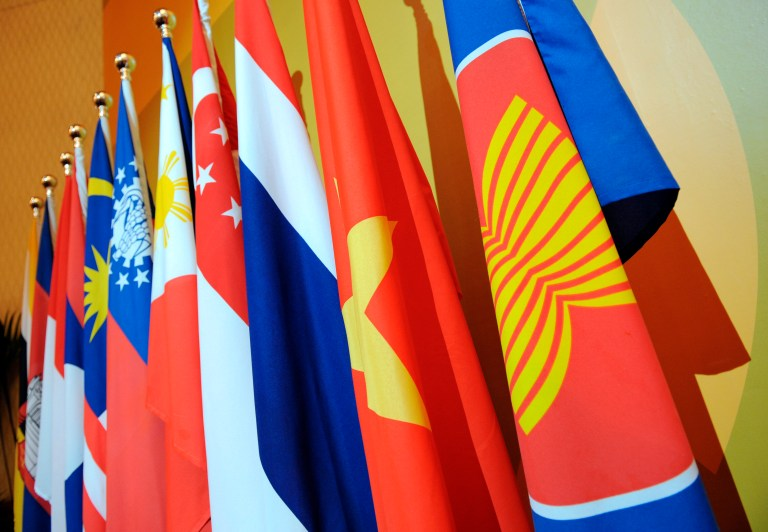 The Association of Southeast Asian Nations (ASEAN) flag leads the flags of the 10-member countries during the ASEAN Regional Forum meeting in Singapore.