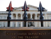 A sign marks the U.S Treasury Department in Washington, U.S., August 6, 2018.     REUTERS/Brian Snyder - RC1FC4F57DD0