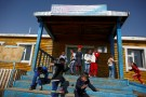 "Pupils leave the village school in Tsagaannuur, Khovsgol aimag, Mongolia, April 23, 2018. People who are between 35-40 years old, belong to the last generation that speak the Dukhan language, linguist Elisabetta Ragagnin said. Together with the head teacher of the school in Tsagaannuur, she is writing grammar and textbooks in the nomad's native tongue to help preserve traditional knowledge, she said. REUTERS/Thomas Peter    SEARCH ""REINDEER HERDERS"" FOR THIS STORY. SEARCH ""WIDER IMAGE"" FOR ALL STORIES. - RC13671A99A0"