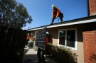 Workers lift a solar panel onto a roof during a residential solar installation in Scripps Ranch, San Diego, California, U.S. October 14, 2016. Picture taken October 14, 2016.       REUTERS/Mike Blake - S1AEUJDNLIAD