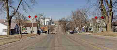 The road leading into town of Dedham, Iowa.