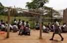 Students eats their lunch at Kyamusansala Primary School in Masaka in southern Uganda March 24, 2009. MALTA OUT. NO COMMERCIAL OR EDITORIAL SALES IN MALTAREUTERS/Darrin Zammit Lupi (UGANDA) - PM1E5560XG401