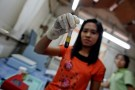 "A lab worker holds up a test-tube of blood before conducting HIV tests at Medecins Sans Frontieres-Holland (AZG)'s clinic in Yangon February 21, 2012. Tens of thousands of lives are at risk in Myanmar due to an anticipated funding shortfall to treat people living with HIV and tuberculosis, medical charity Medecins Sans Frontieres (MSF) warned Wednesday, urging international donors to provide immediate support to the impoverished country. Myanmar is already facing ""a devastating gap"" between people's needs and access to treatment and a decision by the Global Fund to fight AIDS, Tuberculosis and Malaria to cancel funding for 2013 because of a lack of donor money could worsen the situation, the report ""Lives in the balance: the urgent need for HIV and TB treatment in Myanmar"" said. Picture taken February 21, 2012.   REUTERS/Soe Zeya Tun (MYANMAR - Tags: SOCIETY HEALTH) - GM1E82M0ZJO01"
