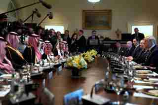 U.S. President Donald Trump and Saudi Arabia's Crown Prince Mohammed bin Salman sit down to a working lunch with their delegations at the White House in Washington.