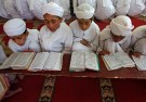 Boys read the Koran inside Markaz Al-Madrasa Al-Islamia, an Islamic seminary and orphanage, during the Muslim fasting month of Ramadan in Shadipora on the outskirts of Srinagar May 20, 2018. REUTERS/Danish Ismail - RC14F69A05E0