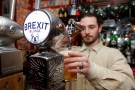 Thibault, barman at the Cricketer English Pub, serves a Brexit draft beer in Paris, France, December 17, 2018. REUTERS/Charles Platiau - RC1542626700
