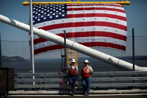 Ironworkers and brothers Randy (L) and Peter Meche, stand by during a dedication ceremony for the new Governor Mario M. Cuomo Bridge that is to replace the current Tappan Zee Bridge over the Hudson River in Tarrytown, New York, U.S., August 24, 2017. REUTERS/Mike Segar - RC1A71EE0590