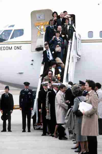Former Iranian hostages and their families disembark their plane upon their arrival at Andrews Air Force Base. / National Archives