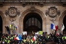 "Protesters wearing yellow vests gather in front of the Opera House as part of the ""yellow vests"" movement in Paris, France, December 15, 2018.  REUTERS/Christian Hartmann - RC180E57DFC0"