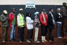 People queue to cast their vote at a polling station during a presidential election re-run in Gatundu, Kenya October 26, 2017.  REUTERS/Siegfried Modola - RC17AAEA3B20