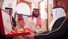 Saudi Arabia's Crown Prince Mohammed bin Salman Al Saud receives a gift from Bahraini King Hamad bin Isa Al Khalifa in Manama, Bahrain, November 26, 2018.  Bandar Algaloud/Courtesy of Saudi Royal Court/Handout via REUTERS   ATTENTION EDITORS - THIS PICTURE WAS PROVIDED BY A THIRD PARTY? - RC12300BE420