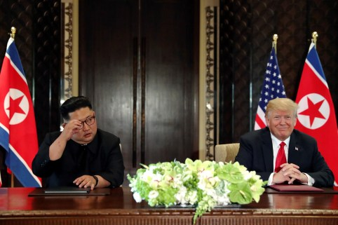 U.S. President Donald Trump and North Korea's leader Kim Jong Un hold a signing ceremony at the conclusion of their summit at the Capella Hotel on the resort island of Sentosa, Singapore June 12, 2018. Picture taken June 12, 2018.