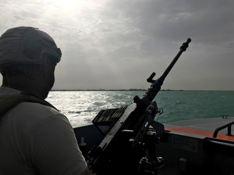UAE navy soldier patrols at Al-Mokha port in Yemen