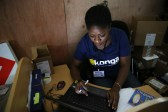 A staff inputs data into a computer at the warehouse of Konga online shopping company in Ilupeju district in Nigeria's commercial capital Lagos September 13, 2013.  REUTERS/Akintunde Akinleye(NIGERIA - Tags: BUSINESS EMPLOYMENT) - GM1E9BB19TI01