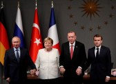 German Chancellor Angela Merkel, Russian President Vladimir Putin, Turkish President Tayyip Erdogan and French President Emmanuel Macron attend a news conference after a Syria summit, in Istanbul, Turkey October 27, 2018. REUTERS/Murad Sezer     TPX IMAGES OF THE DAY - RC1284F2EEB0