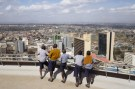 Schoolchildren look out at the central business district from atop the Kenya International Convention Centre in Nairobi, Kenya, August 25, 2015. REUTERS/Joe Penney - GF10000182190