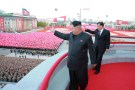 North Korean leader Kim Jong Un (L) and senior Chinese Communist Party official Liu Yunshan (R) wave during celebration of the 70th anniversary of the founding of the ruling Workers' Party of Korea, in this undated photo released by North Korea's Korean Central News Agency (KCNA) in Pyongyang on October 12, 2015. Isolated North Korea marked the 70th anniversary of its ruling Workers' Party on Saturday with a massive military parade overseen by leader Kim Jong Un, who said his country was ready to fight any war waged by the United States. REUTERS/KCNA          TPX IMAGES OF THE DAY     