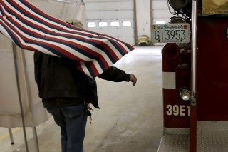 A voter exits a voting booth after filling out his ballot in the U.S. presidential primary election at the Stark Volunteer  Fire Department in the village of Stark, New Hampshire, February 9, 2016.  REUTERS/Mike Segar - GF10000302166
