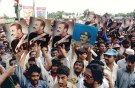 Followers of late Pakistan military ruler General Mohammad Zia-ul-Haq carry his pictures as they assemble at his grave in Islamabad on August 17 to mark his 8th death anniversary. Some 10,000 people took part in the rally and vowed to oust Prime Minister Benazir-Bhutto's government. Zia was killed in a mysterious plane crash in 1988. - PBEAHUMWKBI