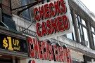 A sign is seen above a check cashing and loan shop in Jersey City, New Jersey, June 2, 2016. REUTERS/Mike Segar  - S1AETHQAPEAA