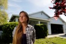 Whitney Hurst stands in front of the house that she rents from Invitation Homes in Esparto, California, U.S. April 24, 2018. Picture taken April 24, 2018.  To match Special Report USA-HOUSING/INVITATION.  REUTERS/Fred Greaves - RC17AE180000