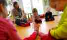 Children play with their nursery school teacher at their Kindergarten in Hanau, 30km (18 miles) south of Frankfurt, March 12, 2013. Despite a drive in German Chancellor Angela Merkel's first term to boost the number of childcare spots, Germany's birthrate remains one of the lowest in Europe.  REUTERS/Kai Pfaffenbach (GERMANY - Tags: POLITICS EDUCATION SOCIETY) - BM2E93C113J01