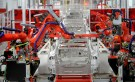 Robotic arms assemble Tesla's Model S sedans at the company's factory in Fremont, California, June 22, 2012. Tesla began delivering the electric sedan to customers on June 22.   REUTERS/Noah Berger   (UNITED STATES - Tags: TRANSPORT SCIENCE TECHNOLOGY BUSINESS) - TM3E86M1CK701