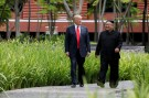 U.S. President Donald Trump and North Korea's leader Kim Jong Un walk together before their working lunch during their summit at the Capella Hotel on the resort island of Sentosa, Singapore June 12, 2018. Picture taken June 12, 2018. REUTERS/Jonathan Ernst - RC116285B8A0