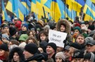 A boy holds a poster during a memorial rally to commemorate people who were killed during the uprising on Maidan square a year ago, in Kiev February 22, 2015.  REUTERS/Valentyn Ogirenko  (UKRAINE - Tags: ANNIVERSARY CIVIL UNREST) - GM1EB2M1P2901